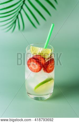 Glass Of Tasty And Cold Strawberry And Lime Lemonade Summer Cold Drink Green Background Vertical