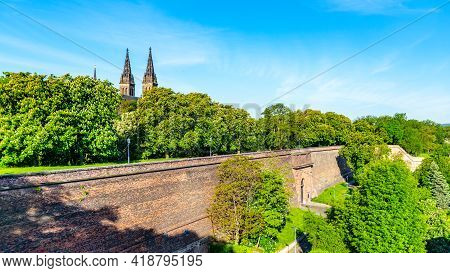 Spires Of Basilica Of St Peter And St Paul In Vysehrad And Massive Brick Fortification Walls, Prague
