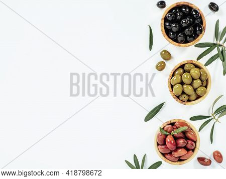 Set Of Green Olives, Black Olives And Red Kalmata Olives On White Background, Copy Space. Top View O