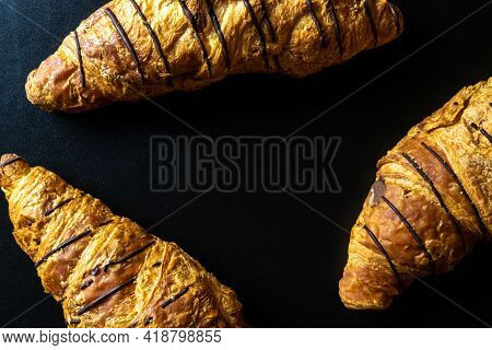 Croissant Chocolate. Freshly Baked Bread Or French Pastry Croissants With Jam On Black Bakery Table.