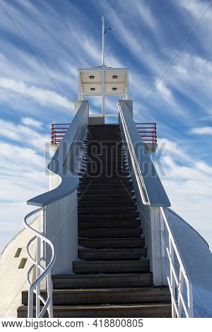 The Wooden Steps Lead To The Top Of An Old Lighthouse At Oulu, Finland. The Winter Sky Emphasizes Th