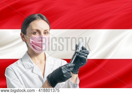 Girl Doctor Prepares Vaccination Against The Background Of The Austria Flag. Vaccination Concept Aus