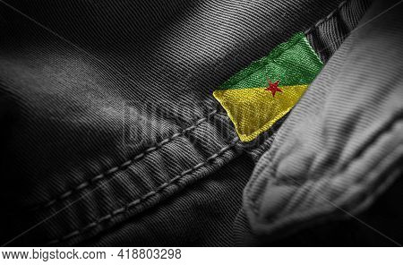 Tag On Dark Clothing In The Form Of The Flag Of The French Guiana