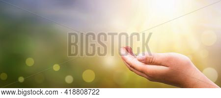 Human Open Empty Hand Up Over Blurred Sunset Background