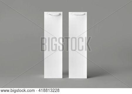 Blank Tall White Wine Bottle Bag Mockup Set, Isolated, 3D Rendering. Empty Carry Handbag For Wine Or