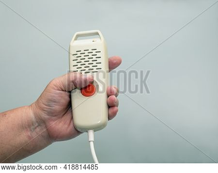 Close Up Senior Woman Hand Holding And Pushing Hand Emergency Button In Hospital Patient Room; Press