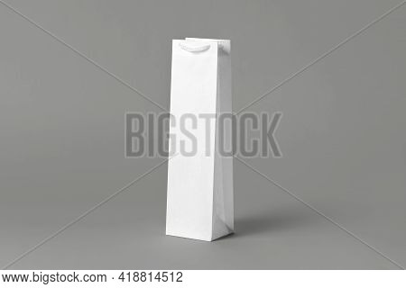 Blank tall white wine bottle bag mockup set, isolated, 3d rendering. Empty carry handbag for wine or vodka mock up. Clear paper packaging fit for store branding.