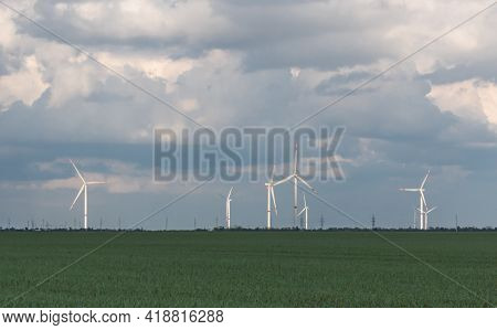 A Panoramic View Of The Wind Turbines For Power Generation, Which Are Located On The Horizon Under T