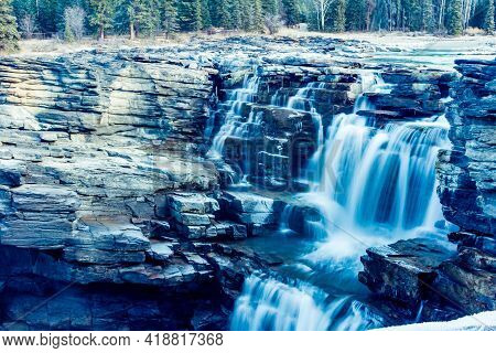 Water Thunders Over The Athabasca Falls. Jasper National Park, Alberta, Canada