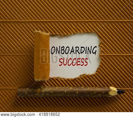 Onboarding Success Symbol. Words 'onboarding Success' Appearing Behind Torn Brown Paper. Beautiful B