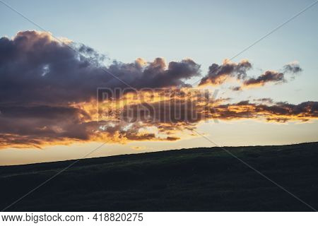 Beautiful Mountain Scenery With Warm Golden Dawn Light In Cloudy Sky. Scenic Contrasting Landscape W