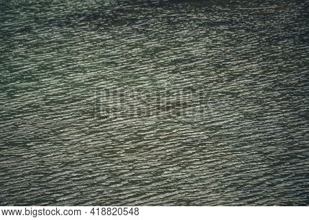 Texture Of Dark Green Calm Water Of Lake. Meditative Ripples On Water Surface. Nature Minimal Backgr