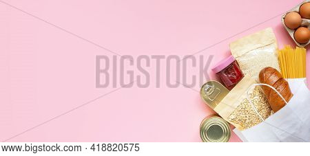 Donation Food On Pink Background With Copy Space. Banner. Mock Up. Rice, Canned Food, Oat Flakes, Eg