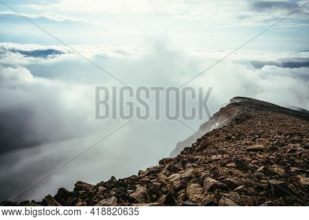 Atmospheric Highlands Scenery On Top Of Mountain Ridge Above Thick Low Clouds. Minimalist View From