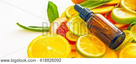 Natural Cosmetics With Vitamin C, A Bottle With A Cosmetic Product With Citrus Essential Oil On The