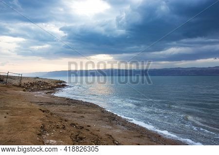Deserted Shore Of Dead Sea On Jordanian Side In Off-season, View Of Israel, Beach Is Closed During C