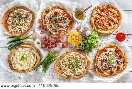 A Close Up A Set Of Hungarian Traditional Langos With Crusty Garlic Edges Served With Vegetables, Cr