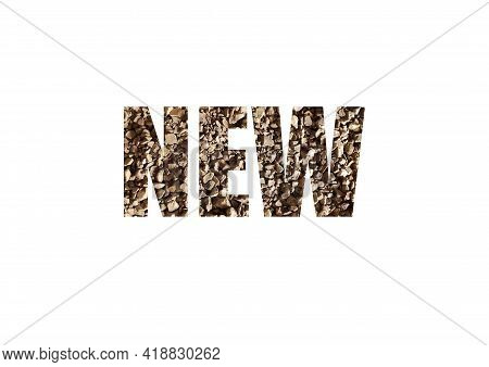 Brown Texture Of Instant Coffee. Shot Through The Cut-out Silhouette Of The Word New