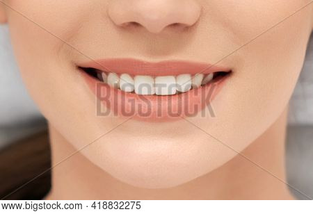 Close Up Of Young Attractive Woman With Beautiful Smiling And White Teeth On Procedure In Beautician