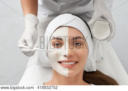 Top View Portrait Of Smiling Beautiful Young Woman On Beauty Procedure In Beautician. Concept Of Spe