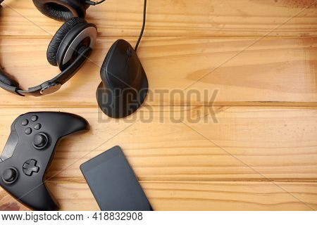 Top View Of Ergonomic Gaming Accessories With Game Controller, Vertical Mouse, Headphones And Mobile