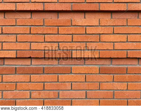 Red Brick Wall In Rows, Tiers. Masonry, Ledge, 2 Lines Of Recess, Deepening. The Wall Is Not New, It