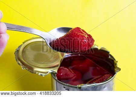 Metal Jar With Canned Strawberries Isolated On Yellow Background Close Up