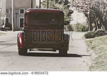 04-16-2020 Vienna, Md, Usa: A Faded Fine Art Image Of A Red Shiny Vintage Pickup Truck On  A Byway A