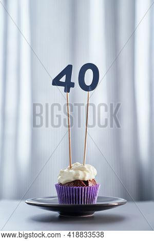 Tasty Chocolate Homemade Anniversary Cupcake Or Muffin With Number 40 Forty On Black Plate And Brigh