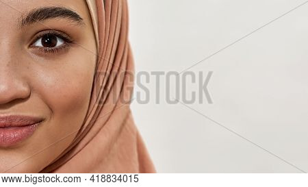 Cheerful Young Arabian Woman In Traditional Hijab Looking At Camera On White Background With Copy Sp