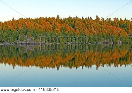 Alpenglow And Evening Reflections On Jenny Lake In The Boundary Waters In Minnesota