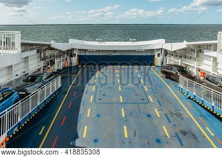 Ferryboat Transferring Cars Across The Sea. Concept Of Transportation, Cargo,logistics,delivery And