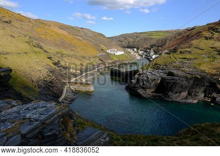 Boscastle As Seen From Penally Point. The Sun Is Highlighting Boscastle And People Can Be Seen On Th