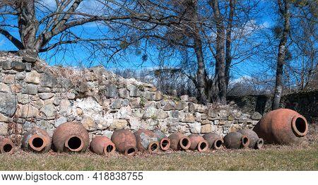 Qvevri, Georgian Traditional Jug For Wine Making Near The Ancient Stone Wall