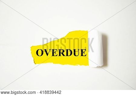 Overdue The Text Is Written On A White Background And A Yellow Piece Of Paper
