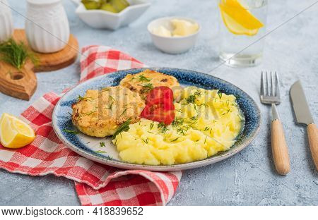 Homemade Fish Cakes Or Cutlets With Mashed Potatoes On A Blue Plate On A Light Concrete Background.