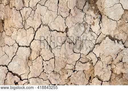 Brown Dry Cracked Soil Background. Dry Land Ground Background. Top View, Flat Lay