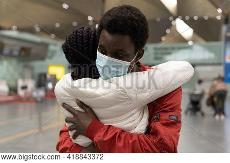 Closeup Of African Man In Protective Mask Hug Woman, Meet Girlfriend From Arrival In Airport. Welcom