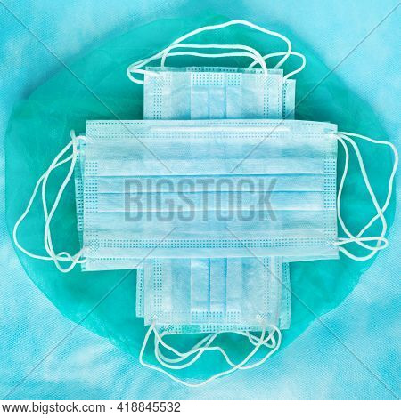 Group Of Antiviral Protective Face Masks On Blue Medical Background. World Coronavirus Covid-19 Pand