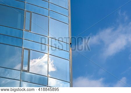 Closeup Of Glass Building Against Blue Sky As Modern Architectural Background