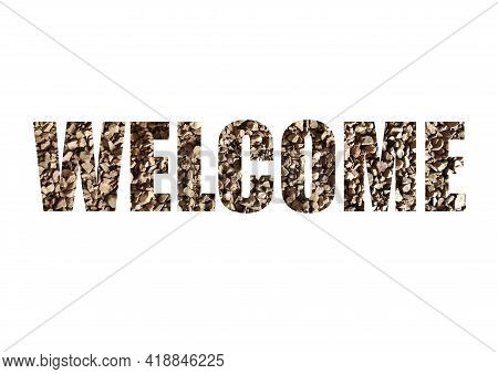Brown Texture Of Instant Coffee. Shot Through The Cut-out Silhouette Of The Word Welcome