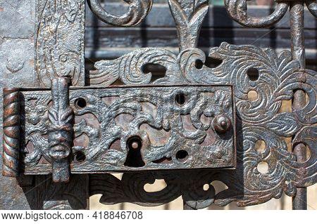 Pilsen, Czech Republic, 1.09.2019 - Medieval Lock On Cast Iron Door Of Plague Column. Architectural