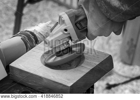 Carpenter Grinds A Wooden Part With A Hand Sander. Joinery. Carpenters Work In The Workshop. Artisti