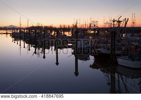 Steveston Harbour Calm Twilight. Twilight Dawn View Of Steveston Harbour And Mount Baker On The Fras