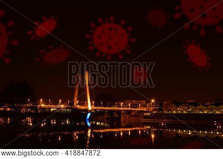 European Lockdown Night With Coronavirus In The Sky. Red Covid-19 Viruses Fly Over Lighting Bridge.