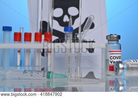 Covid-19 Vaccine Vial On A Lab Desk With Death Danger Symbol. Mortal Side Effects Of Coronavirus Dru