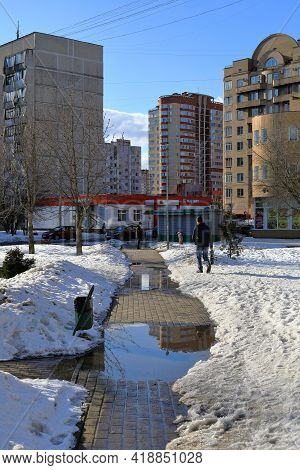Balashikha, Russia - March 19, 2021. Residential Neighborhood In The Spring. Snow Melting On The Foo