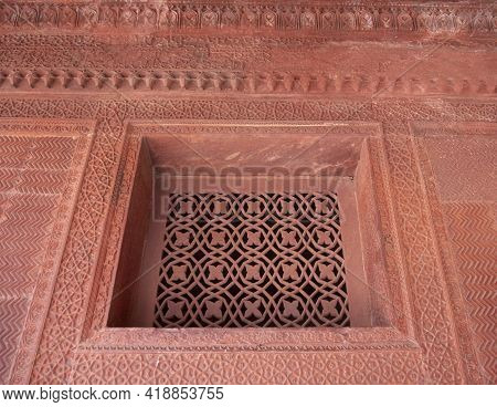Fatephur Sikri, India- March, 27, 2019: Intricate Carved Stone Window Grille On An Ancient Mughal Pa