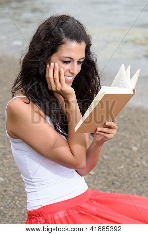 Dreamy Girl Reading Book At Beach