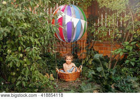 Kid Riding Hot Air Balloon. Cute Child On Airship. The Toy Air Balloon For Child. Hot Air Balloon. H
